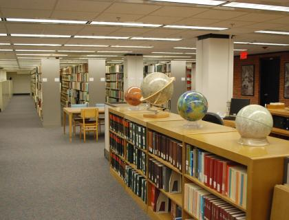 Interior of Map and Government Information Library, showing globes and shelves of books